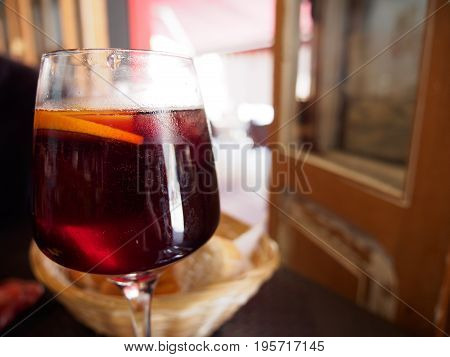 Close-up detail of a wine glass filled with Sangria a traditional spanish cocktail in a local restaurant. Valencia Spain. Travel and local cuisine concept.