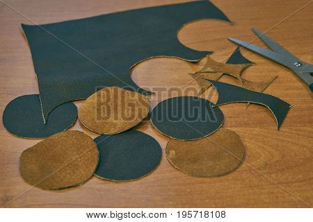 Pieces Of Brown Leather On A Desk