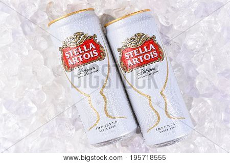 IRVINE CA - JULY 17 2017: Cans of Stella Artois Beer closeup on Ice. Stella has been brewed in Leuven Belgium since 1926 and launched as a festive beer named after the Christmas star.
