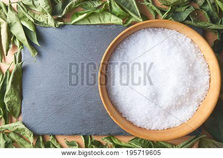 Wooden Bowl Of Sea Salt On Slate