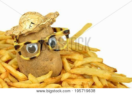 potato with straw hat and glasses in a pile of golden french fries