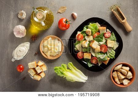caesar salad and ingredients at table background