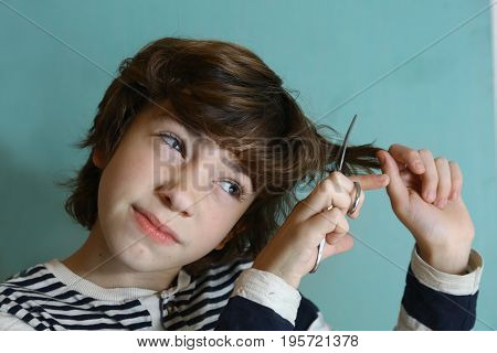 Teenager Boy Cut His Hair With Scissors
