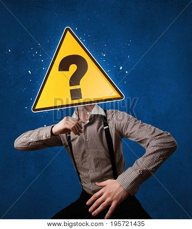 Casual businessman holding yellow sign with question mark