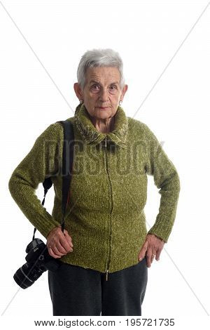 older woman with a SLR camera on white background