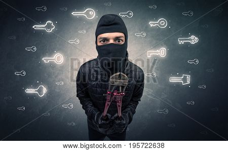 Burglar standing with tools in his hand.