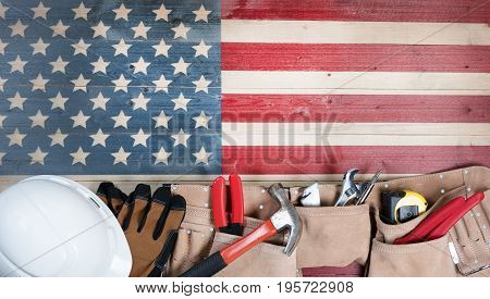 Labor Day background with USA rustic wooden flag and utility belt plus hard hat