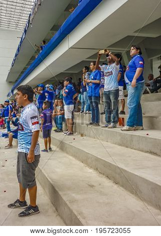 GUAYAQUIL, ECUADOR, NOVEMBER - 2016 - Fans watching at soccer match between Emelec against Liga de Quito playing at the George Capwell Stadium in Guayaquil city Ecuador.