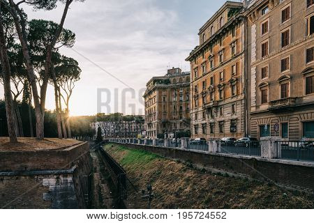 Rome Italy - August 19 2016: Sunset on Piazza Adriana in Rome near Castel Sant Angelo. The Mausoleum of Hadrian usually known as Castel Sant'Angelo is a towering cylindrical building in Rome