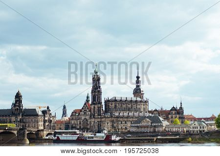 Evening view of Cathedral of the Holy Trinity or Hofkirche, Bruehl's Terrace or The Balcony of Europe. Sunset on Elbe river in Dresden, Saxony, Germany, Europe.