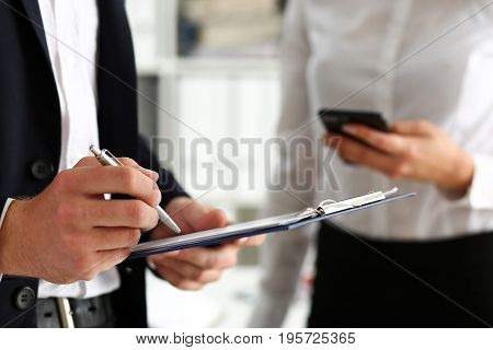 Male Arm In Suit Hold Silver Pen And Pad