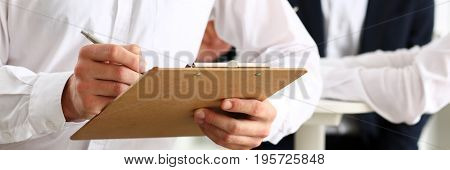 Male Arm In Suit Hold Silver Pen