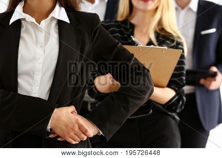 Group Of People In Suit Stand In Office