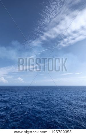 Vast blue ocean and sky background with moderate waves