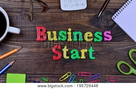 The words Business Start on wooden table