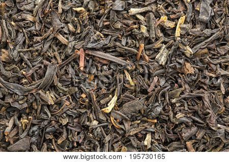 texture of Chinese oolong black tea, macro image of loose leaves