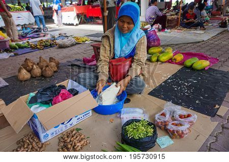 Keningau,Sabah-June 29,2017:Local trader selling various vegetables at a local market Tamu in Keningau,Sabah.Its a place where all farmers,fishermen & vendors gathers weekly to sell their products