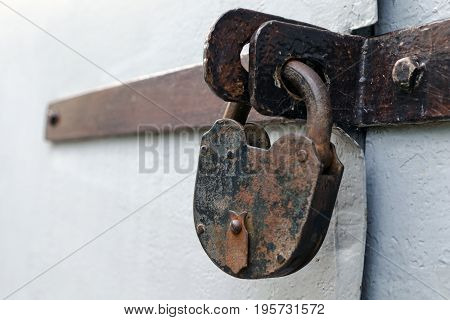 Old Rusty But Reliable Barn Door Lock - The Concept Of Prohibition Or Protection