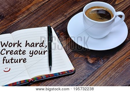 Text Work hard. Create your future on notebook page