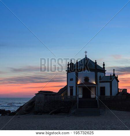 Chapel Senhor da Pedra at dusk, Miramar Beach, Portugal.