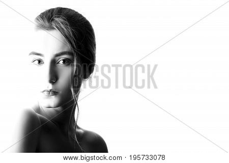 beautiful serious female portrait on white background isolated, monochrome