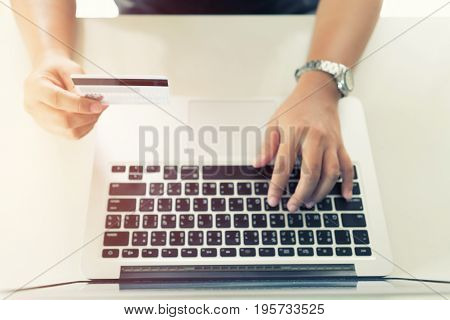 Woman Hand Holding Credit And Online Shopping Activity
