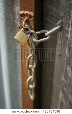 Chain And Padlock On A Building Door