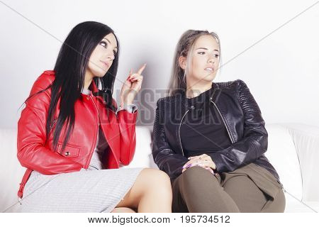 Woman Correcting Another Woman Behavior.