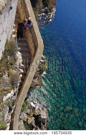 Descending The Stairs Carved In The Cliff Of Bonifacio.