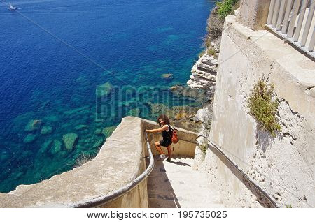 Descending The Stairs Carved In The Cliffs Of Bonifacio