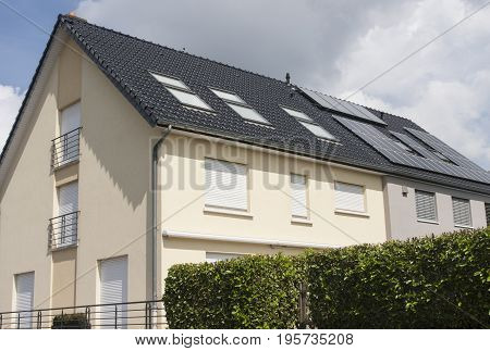 Solar panels on the roof of a house in Europe