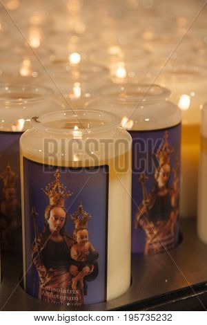 Several glowing prayer candles in a church