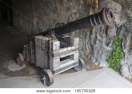 An ancient authentic cannon on a wood support