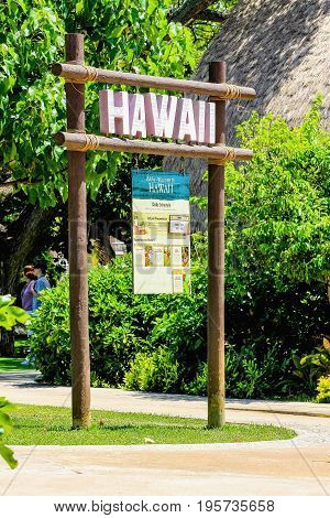 Honolulu Hawaii - May 27 2016:Hawaii signpost at the entry of the Hawaiian Village at the Polynesian Cultural Center a popular tourist attraction on Oahu.