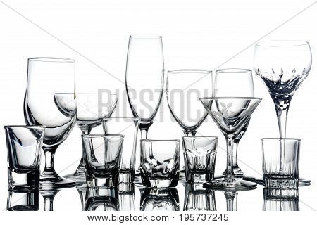 Collage of empty glasses on white background.