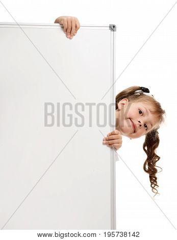 Portrait of cute little girl looking out whiteboard