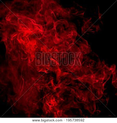 Red smoke over a black studio background
