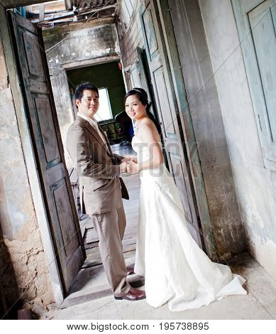 couples of groom and bride portrait in old church after wedding ceremony