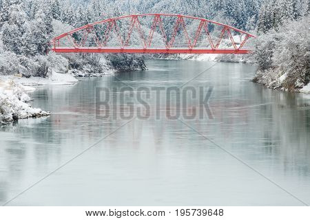 winter landscape with Red Bridge along Tadami River in Fukushima Japan