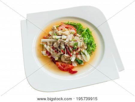 Thai salad with glass noodles prawns and peanuts on top with Chicken meat in a bowl close-up, Spicy Salad(Yum Woon Sen), isolated on white background.