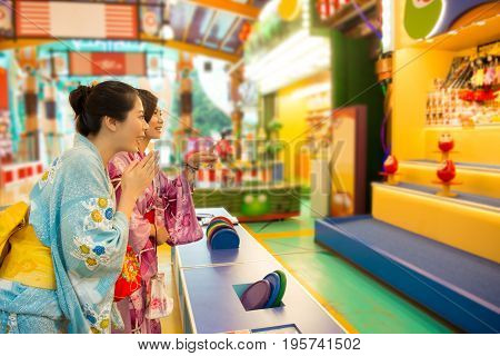 Japanese Woman Playing Hit Tumbling Dolls
