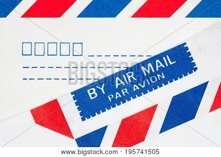 closeup text by airmail on envelope paper