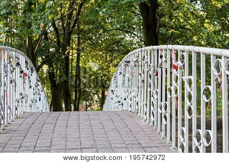Bridge In City Park. Railings With Hanging Love Locks.