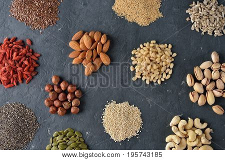 Different super foods on a gray background healthy eating concept