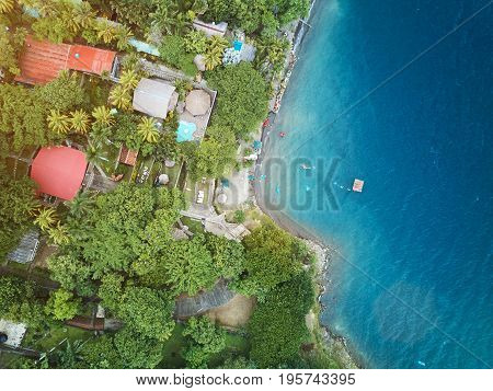 Coastline in lagoon with blue water aerial drone view. People spent vacation doing kayaking