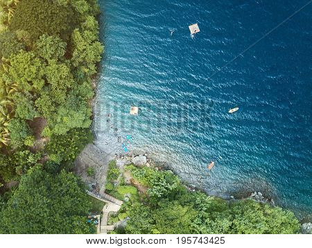 Top view of blue lagoon water. People doing water beach activity