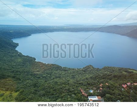 Lagoon apoyo in Nicaragua aerial drone view. Panoramic view on apoyo lagoon
