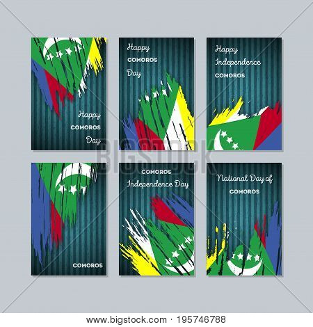 Comoros Patriotic Cards For National Day. Expressive Brush Stroke In National Flag Colors On Dark St