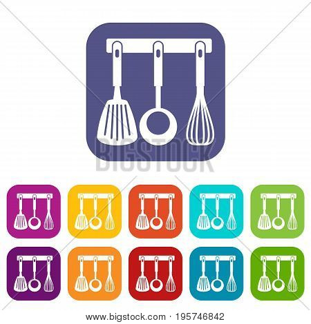 Spatula, ladle and whisk, kitchen tools on a hanger icons set vector illustration in flat style In colors red, blue, green and other