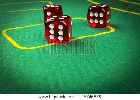 risk concept - playing dice on a green gaming table. Playing a game with dice. Red casino dice rolls. Rolling the dice concept for business risk chance good luck or gambling